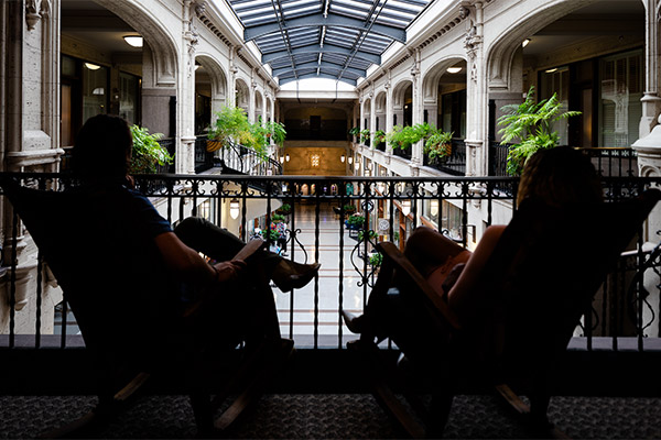 couple on rocking chairs at grove arcade